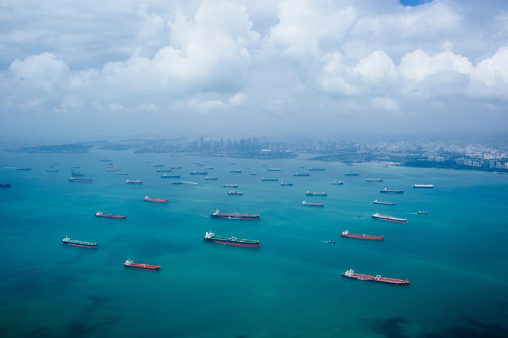 Barges and cargo ships in Singapore Bay.
