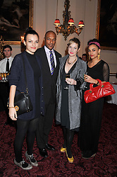 COLIN SALMON and FIONA HAWTHORNE with their daughters left, RUDI and right SASHA at the Audi Ballet Evening held at the Royal Opera House, Bow Street, Covent Garden, London on 22nd March 2012.