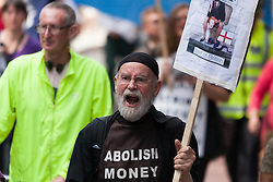 London, June 21st 2014. A protester demands the abolition of money