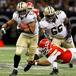 September 23, 2012; New Orleans, LA, USA; New Orleans Saints running back Pierre Thomas (23) breaks a tackle of Kansas City Chiefs linebacker Derrick Johnson (56) during the second quarter of a game at the Mercedes-Benz Superdome. Mandatory Credit: Derick E. Hingle-US PRESSWIRE