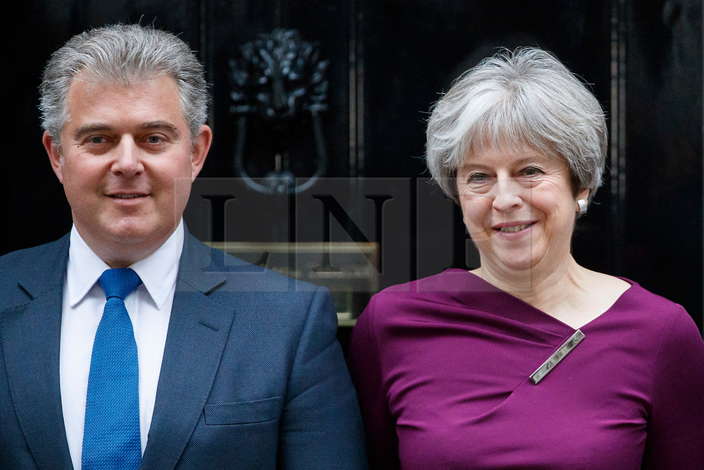© Licensed to London News Pictures. 08/01/2018. London, UK. Prime Minister Theresa May poses with Brandon Lewis, the newly appointed Minister without Portfolio and Conservative Party Chair in Downing Street following a cabinet reshuffle on Monday, 8 January 2018. Photo credit: Tolga Akmen/LNP