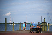 "Annapolis, Maryland - June 05, 2016: People hang out at the pier off Dock Street in Historic Annapolis, Md., Sunday June 5th, 2016. Annapolis is one of the most prone cities in the U.S. to nuisance flooding. <br /> <br /> <br /> A perigean spring tide brings nuisance flooding to Annapolis, Md. These phenomena -- colloquially know as a ""King Tides"" -- happen three to four times a year and create the highest tides for coastal areas, except when storms aren't a factor. Annapolis is extremely susceptible to nuisance flooding anyway, but the amount of nuisance flooding has skyrocketed in the last ten years. Scientists point to climate change for this uptick. <br /> <br /> <br /> CREDIT: Matt Roth for The New York Times<br /> Assignment ID: 30191272A"