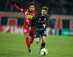 LIVERPOOL, ENGLAND - Thursday, December 10, 2015: Liverpool's Adam Lallana in action against FC Sion's Carlitos during the UEFA Europa League Group Stage Group B match at Stade de Tourbillon. (Pic by David Rawcliffe/Propaganda)