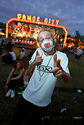Guy with a mask pointing at a fairground, Helter Skelter, June 1998