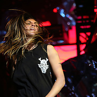 "Jahan Yousaf of the band Krewella performs in front of the ""Light Volcano"", during the Verge Campus Spring Tour concert at the CFE Arena on the University of Central Florida campus, Tuesday, April 8, 2014, in Orlando, Florida.  (AP Photo/Alex Menendez)"