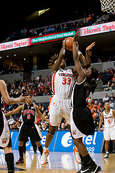 Virginia center Aisha Mohammed (33) shoots over Maryland forward/center Crystal Langhorne (1).  The Virginia Cavaliers women's basketball team fell to the #4 ranked Maryland Terrapins 74-62 at the John Paul Jones Arena in Charlottesville, VA on January 18, 2008.