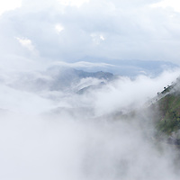 A view of the mountains and fog on the road between Furcy and Seguin.