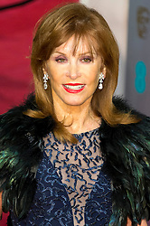 © Licensed to London News Pictures. 14/02/2016. London, UK. STEPHANIE POWERS arrives on the red carpet at the EE British Academy Film Awards 2016 Photo credit: Ray Tang/LNP