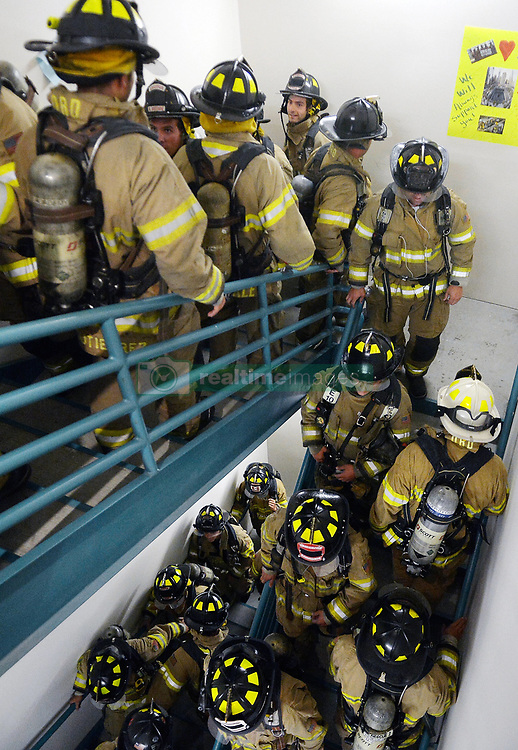 September 11, 2017 - Albuquerque, New Mexico, U.S. - Albuquerque Firefighters honor the fallen FDNY firefighters who died in the Twin Towers 9/11 terrorist attack by climbing the stairs of the Albuquerque Plaza Office Tower on Monday. The firefighter's climbed the stairs 5 times (110 stories), the height of the World Trade Center in full bunker gear. (Credit Image: © Greg Sorber/Albuquerque Journal via ZUMA Wire)