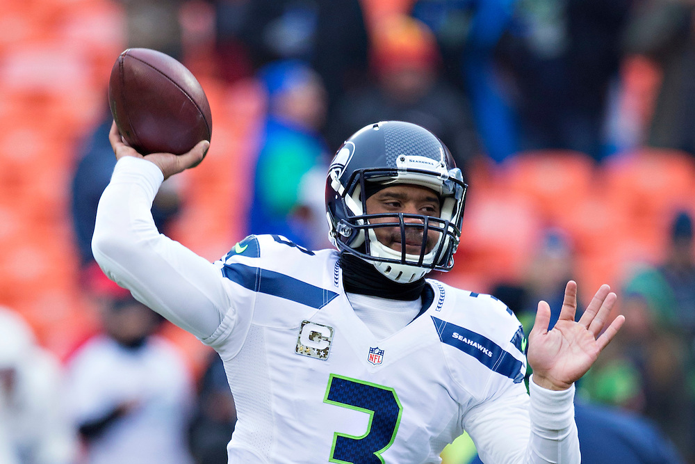 KANSAS CITY, MO - NOVEMBER 16:  Russell Wilson #3 of the Seattle Seahawks warming up before a game against the Kansas City Chiefs at Arrowhead Stadium on November 16, 2014 in Kansas City, Missouri.  The Chiefs defeated the Seahawks 24-20.  (Photo by Wesley Hitt/Getty Images) *** Local Caption *** Russell Wilson