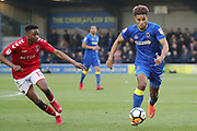 AFC Wimbledon striker Lyle Taylor (33) taking on Charlton Athletic midfielder Joe Aribo (17) during the The FA Cup match between AFC Wimbledon and Charlton Athletic at the Cherry Red Records Stadium, Kingston, England on 3 December 2017. Photo by Matthew Redman.