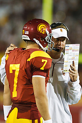 September 11, 2010; Los Angeles, CA, USA;  Southern California Trojans head coach Lane Kiffin talks to quarterback Matt Barkley (7) during a time out during the first quarter at the Los Angeles Memorial Coliseum.