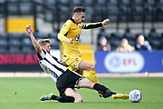 Notts County forward Jonathan Stead (30) tackles Morecambe defender Michael Rose (24)  during the EFL Sky Bet League 2 match between Notts County and Morecambe at Meadow Lane, Nottingham, England on 9 September 2017. Photo by Simon Davies.