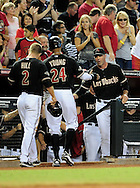 Sep. 24 2011; Phoenix, AZ, USA; Arizona Diamondbacks infielder Aaron Hill (2) and teammate outfielder .Chris Young (24) are congratulated by manager Kirk Gibson after scoring during the first inning against the San Francisco Giants at Chase Field. Mandatory Credit: Jennifer Stewart-US PRESSWIRE