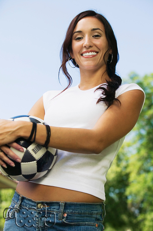 Woman Holding Soccer Ball