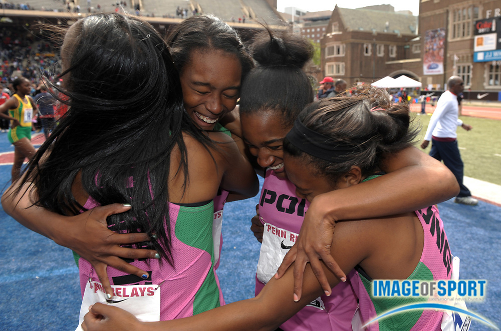 Apr 27, 2012; Philadelphia, PA, USA; Members of the Long Beach Poly girls 4 x 100m relay embrace after winning the Championship of America in 46.35 to become the first U.S. school to repeat as champion in the 118th Penn Relays at Franklin Field. From left: Diamond Thomas and Ariana Washington and Traci Hicks and Tori Myers.