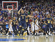 ESPN --  La Salle Explorers guard D.J. Peterson (1) celebrates after beating the Kansas State Wildcats 63-61 during the second round of the 2013 NCAA tournament at the Sprint Center.