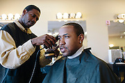 Rap producer Mike Will has his hair trimmed by Rapheal Clark at Strictly Platinum Barber Shop in Marietta, Georgia October 4, 2012.