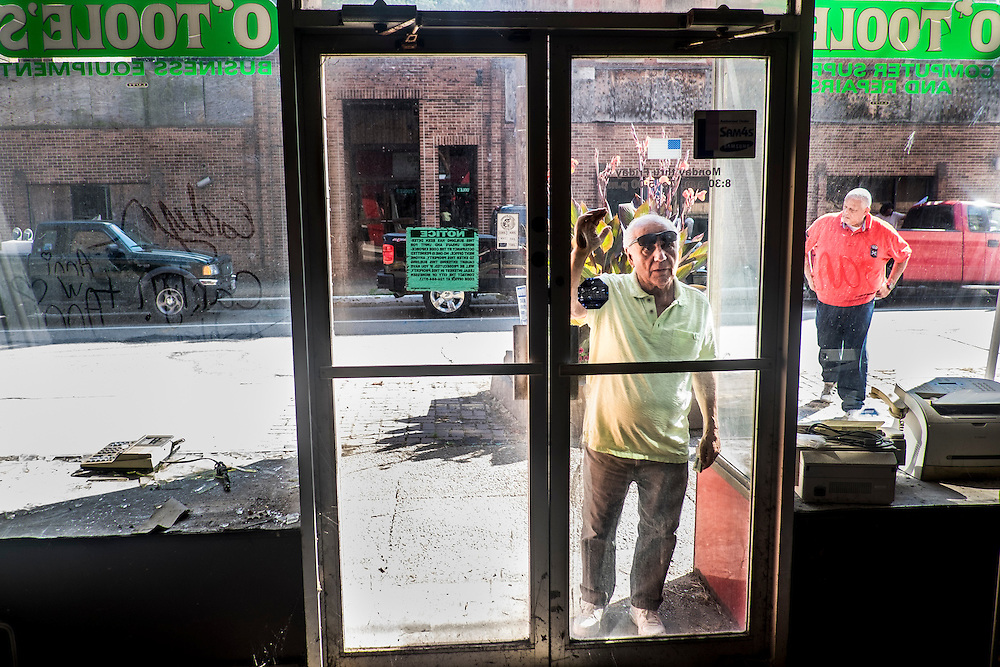 Monessen Mayor Lou Mavrakis looks inside the former O'Toole's business equipment store on Donner Ave. in Monessen, PA.<br /> <br /> Monessen, a third-class city, faces the same problems as th other former steel towns &mdash; declining population and tax revenue after the mills shut down. The city's population has dropped to 7,600 from a high of 20,268 in 1930.