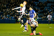 Brentford midfielder Ryan Woods (15) takes it on the chin  during the EFL Sky Bet Championship match between Sheffield Wednesday and Brentford at Hillsborough, Sheffield, England on 21 February 2017. Photo by Simon Davies.