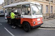 Milkman and traditional milk float