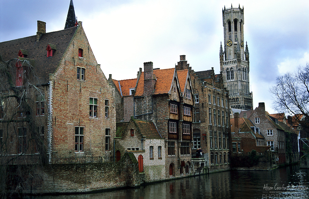 A typical Bruges, Belgium canal from the Rozenhoedkaai with the Belfry that sits in the Market square in the background
