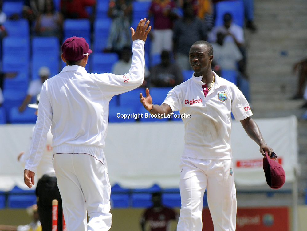 Sunil Narine congratulates Kemar Roach on his 5 wickets - Day 5 of the first test West Indies v New Zealand at Sir Vivian Richards Stadium, Antigua, West Indies.<br /> 29 July 2012. Photo;Randy Brooks/Photosport.co.nz