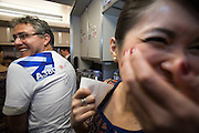 Airbus A380 first commercial flight - Singapore Airlines SQ 380 Singapore-Sydney on October 25, 2007. A hostess places a souvenir kiss on Italian passenger Francisco Miramontes' t-shirt.