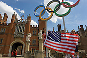 American children stand for a souvenir photo on the Olympic rings that stand at the entrance of King Henry the Eighth's Hampton Court Palace on the first day of competition of the London 2012 Olympic 250km mens' road race. Starting from central London and passing the capital's famous landmarks before heading out into rural England to the gruelling Box Hill in the county of Surrey. Local southwest Londoners lined the route hoping for British favourite Mark Cavendish to win Team GB first medal but were eventually disappointed when Kazakhstan's Alexandre Vinokourov eventually won gold.