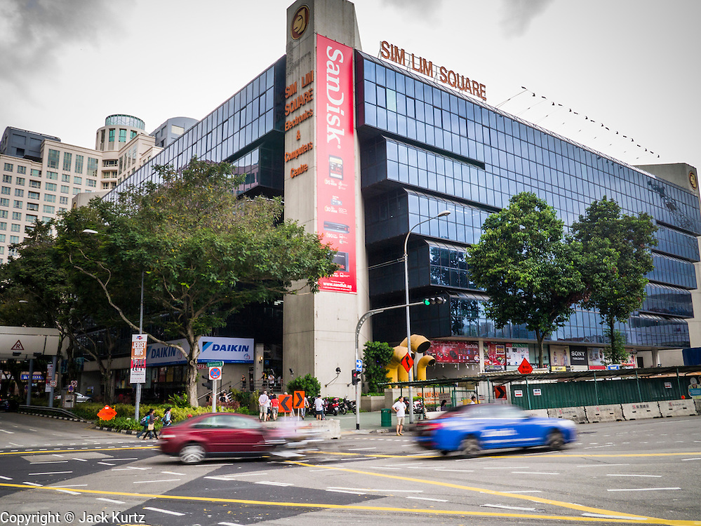 23 DECEMBER 2012 - SINGAPORE, SINGAPORE: Exterior view of Sim Lim Square. Sim Lim Square, commonly referred to as SLS, is a large retail complex that offers a wide variety of electronic goods and services ranging from DVDs, cameras, phones, video cameras, and computer parts and servicing. SLS is opposite the historic  Little India district and close to one of the earliest HDB (Singapore housing agency) developments. SLS is accessible via MRT at Bugis or Little India.   PHOTO BY JACK KURTZ