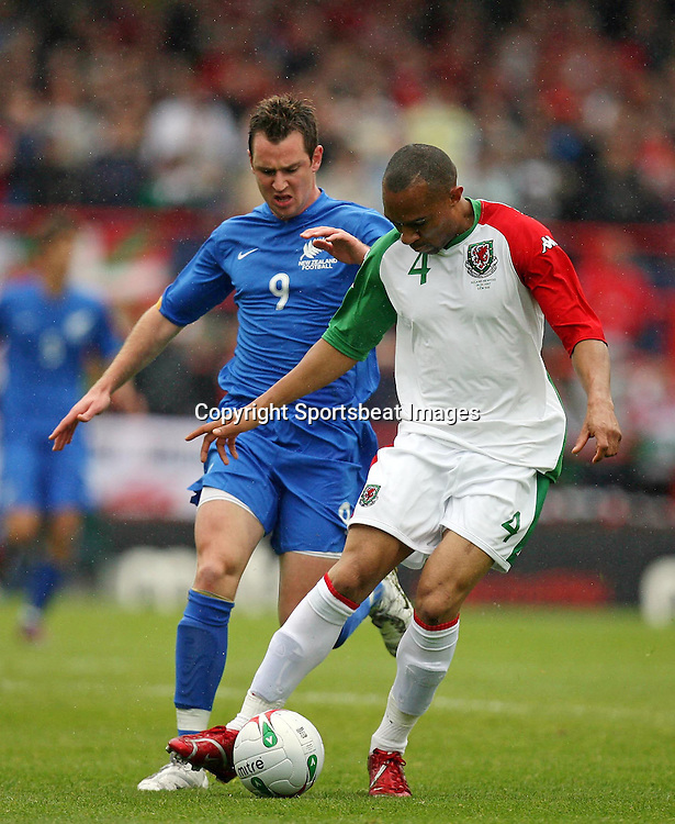 Photo: Rich Eaton.<br /> <br /> Wales v New Zealand. International Friendly. 26/05/2007. Wales Danny Gabbidon (r) shields the ball from New Zealand  goalscorer Shane Smeltz (l)