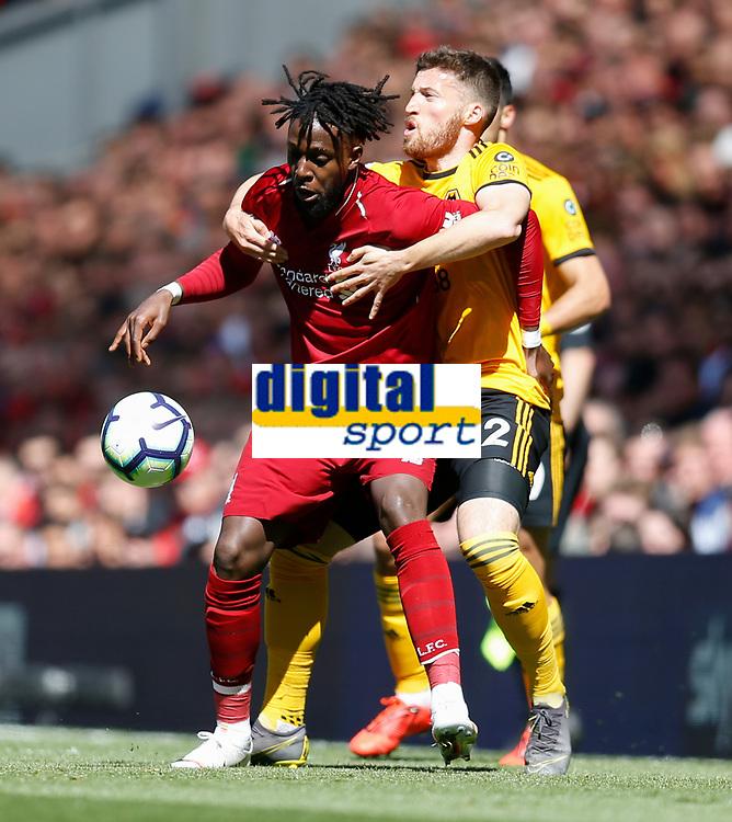 Football - 2018 / 2019 Premier League - Liverpool vs. Wolverhampton Wanderers <br /> <br /> Divock Origi of Liverpool vies with Matt Doherty of Wolverhampton Wanderers at Anfield<br /> <br /> COLORSPORT/BRUCE WHITE
