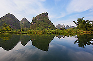 Karst formations reflected on Yulong River, Yangshuo, China