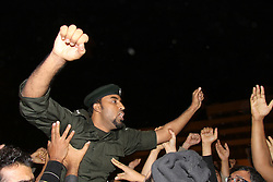 © under license to London News Pictures.  18/02/2011. A Bahraini soldier who defected from the amry arrives to loud cheers at the Salmnya Heath Complex in Manama, Bahrain. Photo credit should read Michael Graae/London News Pictures