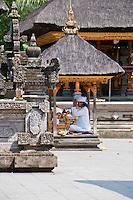 Hindu priest praying at Pura Kebo Edan near ubud, bali, indonesia