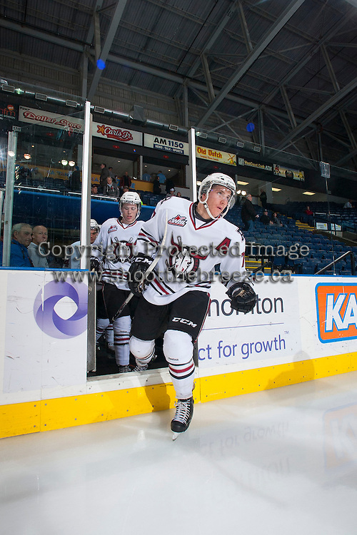 KELOWNA, CANADA - NOVEMBER 6: Brady Gaudet #7 of the Red Deer Rebels enters the ice at warm up against the Kelowna Rockets on NOVEMBER 6, 2013 at Prospera Place in Kelowna, British Columbia, Canada.   (Photo by Marissa Baecker/Shoot the Breeze)  ***  Local Caption  ***