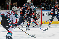KELOWNA, CANADA - DECEMBER 27: Nick Chyzowski #16 of the Kamloops Blazers tries to block a shot by Nick Merkley #10 of the Kelowna Rockets during first period on December 27, 2016 at Prospera Place in Kelowna, British Columbia, Canada.  (Photo by Marissa Baecker/Shoot the Breeze)  *** Local Caption ***