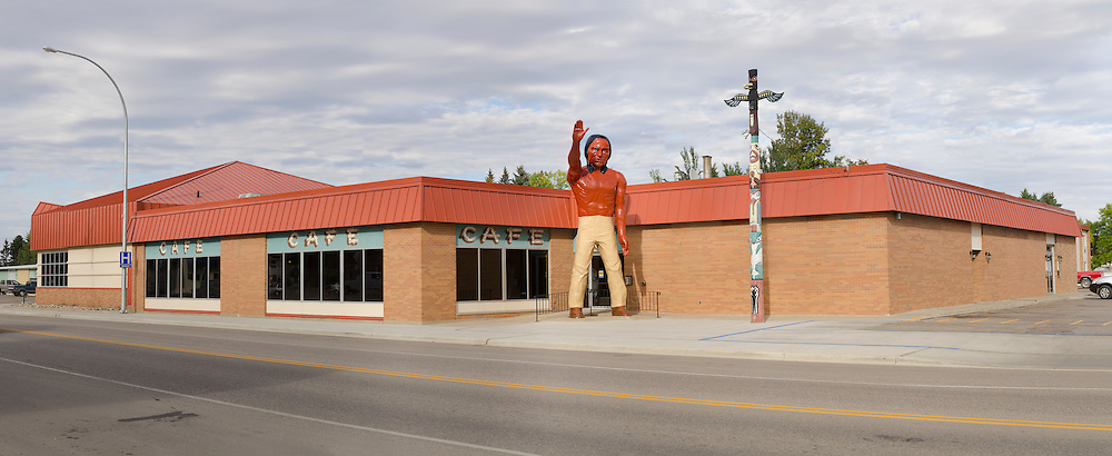 """Photograph of large Indian in front of the Chieftain Conference Center and Motel in center of town on Highway 281. About 20 feet tall. """"The Chieftain Motel"""" in Carrington, North Dakota.."""