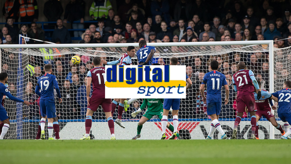 Football - 2019 / 2020 Premier League - Chelsea vs. West Ham United<br /> <br /> Kurt Zouma (Chelsea FC) flashes a header across goal from a Chelsea corner at Stamford Bridge <br /> <br /> COLORSPORT/DANIEL BEARHAM