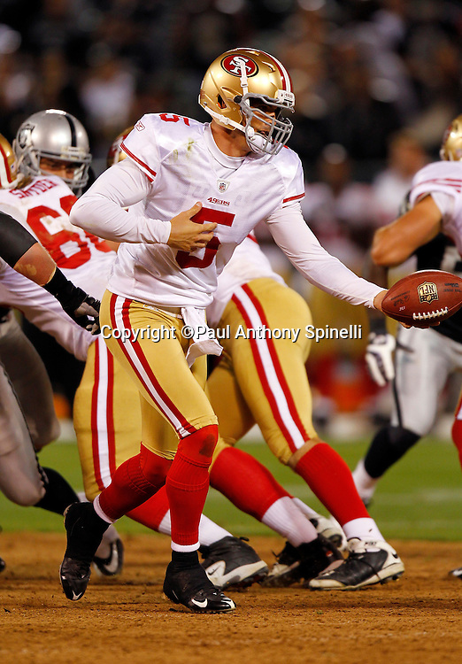San Francisco 49ers quarterback David Carr (5) hands off the ball on a running play during the NFL preseason week 3 football game against the Oakland Raiders on Saturday, August 28, 2010 in Oakland, California. The 49ers won the game 28-24. (©Paul Anthony Spinelli)