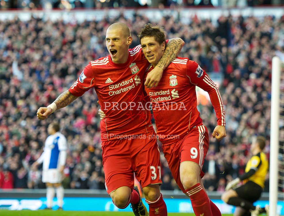 LIVERPOOL, ENGLAND - Sunday, October 24, 2010: Liverpool's Fernando Torres celebrates with team-mate Martin Skrtel after scoring his side's second goal against Blackburn Rovers during the Premiership match at Anfield. (Photo by David Rawcliffe/Propaganda)