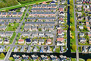Nederland, Flevoland, Almere, 07-05-2015;  Almere-Buiten, Eilandenbuurt eengezinswoningen en stadsvilla's omgeven door waterpartijen met drijvende woningen.<br /> Eilandenbuurt (Island Area), town houses and urban villas surrounded by water.<br /> luchtfoto (toeslag op standard tarieven);<br /> aerial photo (additional fee required);<br /> copyright foto/photo Siebe Swart