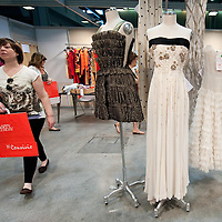 MILAN, ITALY - JUNE 11:  A customer walks by a Gianfranco Ferre' vintage evening dress (C) worn by Beyonce  for sale at Euro 2,500 at the 10th Convivio on June 11, 2010 in Milan, Italy. Convivio is Italy's most high profile charity sale to raise money for ANLAIDS the national association for the fight against AIDS  (Photo by Marco Secchi/Getty Images)