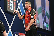Mensur Suljovic during the William Hill PDC World Darts Championship at Alexandra Palace, London, United Kingdom on 18 December 2017. Photo by Shane Healey.