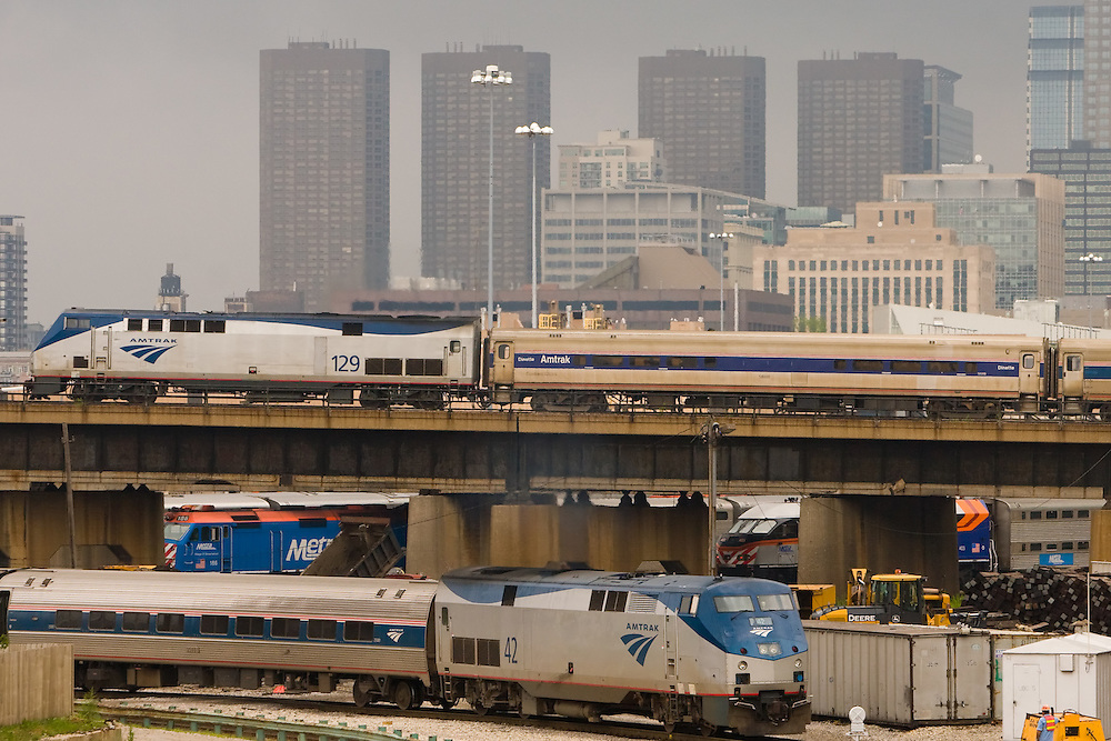 Two Amtrak trains pass in the yards in Chicago, IL.