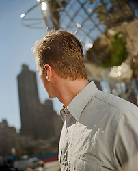 back of a man in New York City on the Upper West Side
