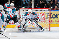 KELOWNA, CANADA - JANUARY 24:  MacKenzie Johnston #22 of the Kelowna Rockets clears the zone while Jordon Cooke #30 of the Kelowna Rockets defends the net against the Seattle Thunderbirds at the Kelowna Rockets on January 24, 2013 at Prospera Place in Kelowna, British Columbia, Canada (Photo by Marissa Baecker/Shoot the Breeze) *** Local Caption ***