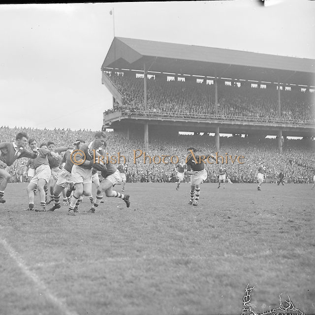 Players tackle each other in the Louth goalmouth during the All Ireland Senior Gaelic Football Championship Final Louth v Cork at Croke Park on the 22nd September 1957. Louth 1-09 Cork 1-07.