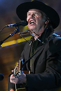 TINLEY PARK, IL - SEPTEMBER 18: Farm Aid co-founder Neil Young performs live at the 20th Anniversary Farm Aid concert benefiting the family farmers affected by Hurricane Katrina September 18, 2005 at The Tweeter Center Chicago, in Tinley Park, Illinois. (Photo by Matt Carmichael)