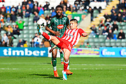 Noor Husin (16) of Accrington Stanley hooks the ball away from Yann Songo'o (4) of Plymouth Argyle during the EFL Sky Bet League 2 match between Plymouth Argyle and Accrington Stanley at Home Park, Plymouth, England on 1 April 2017. Photo by Graham Hunt.